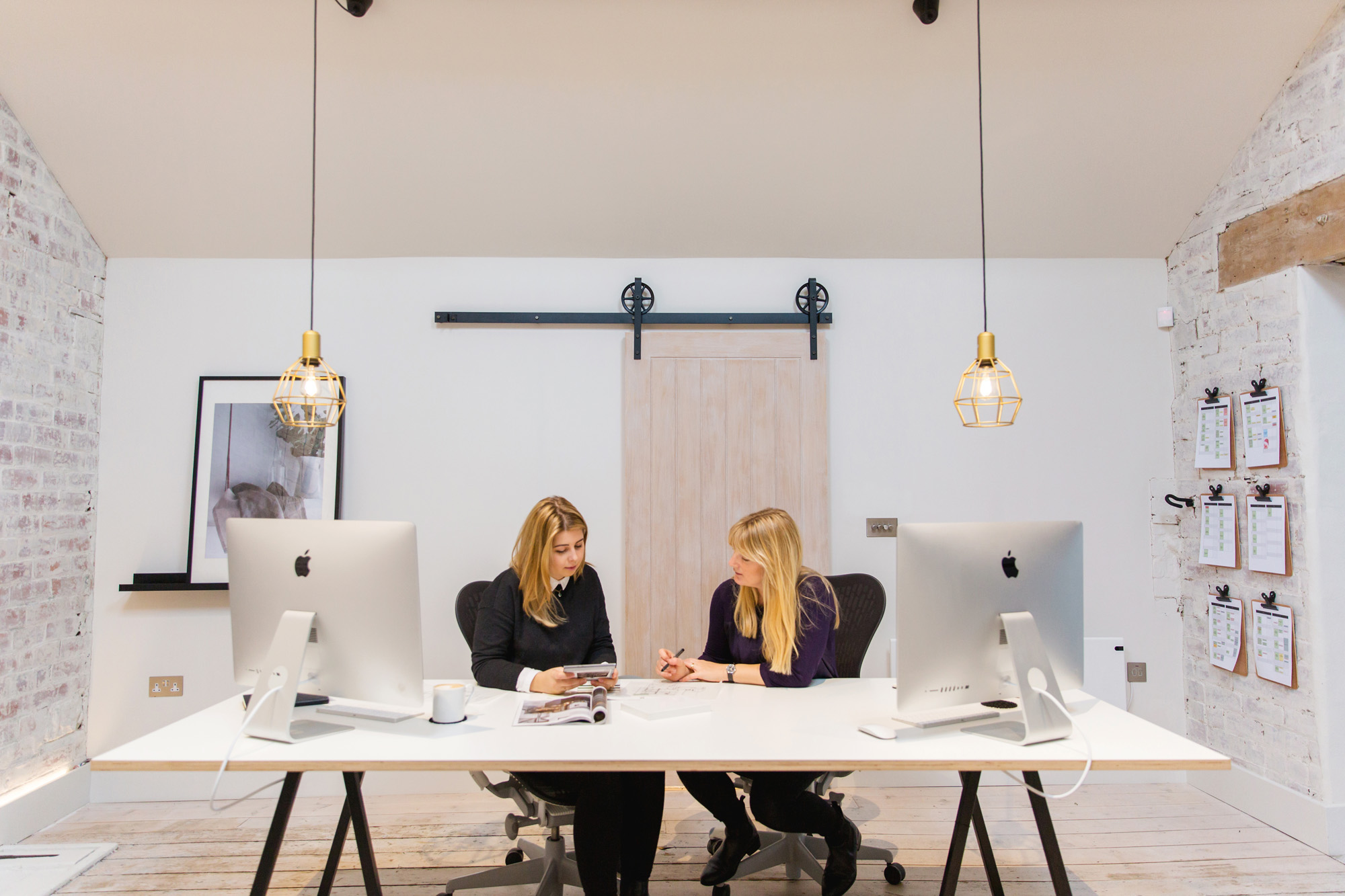 A photograph of two colleagues at Nest Kitchens at work.