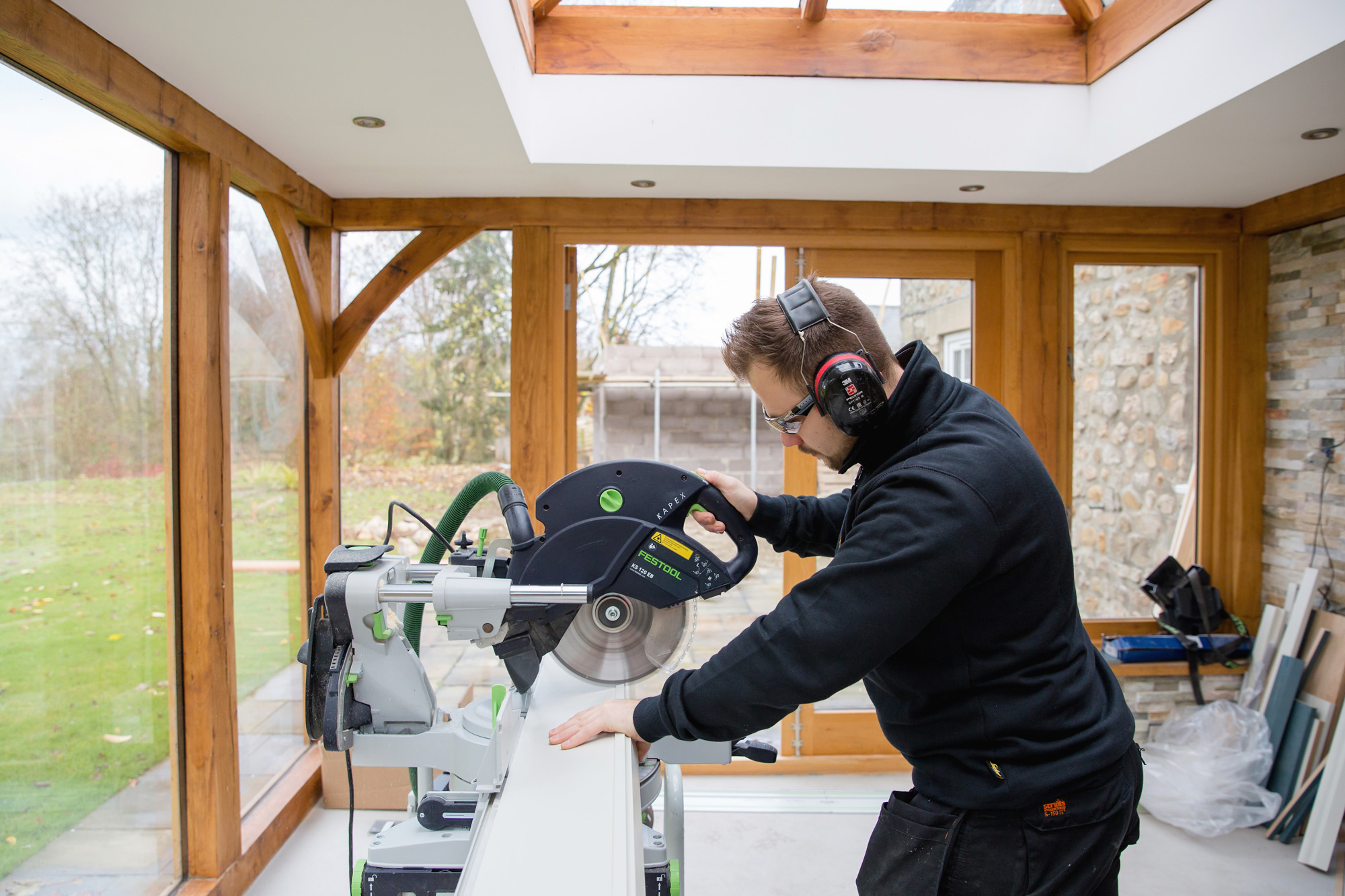 One of Nest Kitchens installers cutting wood to length.